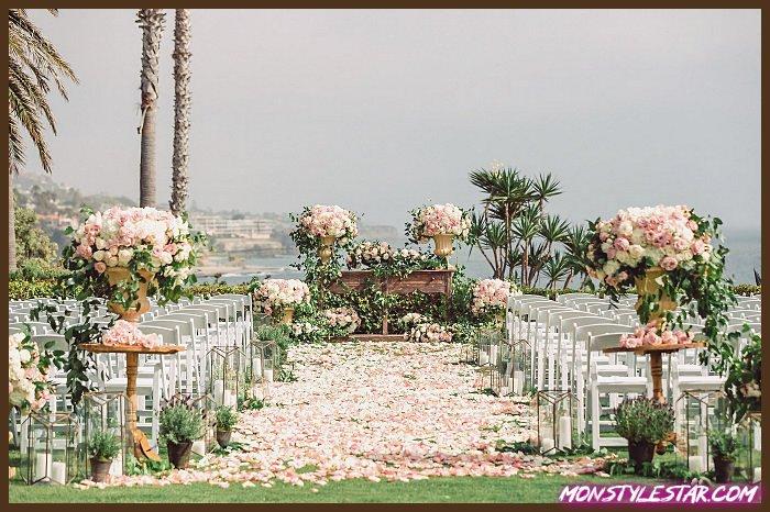Mariage à couper le souffle rempli de fleurs sur la plage à Laguna de Jana Williams Photography